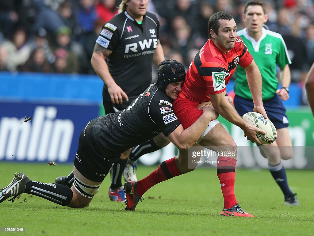 Jean-Marc Dousaain of Toulouse passes the ball during the Heineken Cup match between Ospreys and Stade Toulouse at the Liberty Stadium on December 15, 2012 in Swansea, Wales.