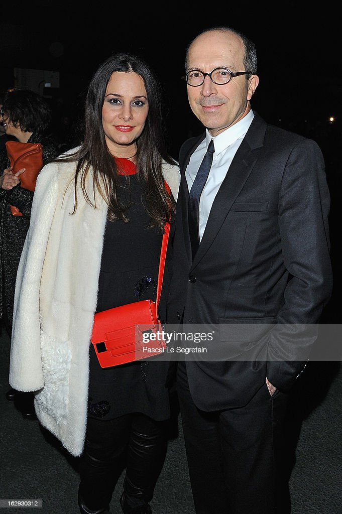 Jean-Marc Loubier (r) and his wife Hedeh attend the Sonia Rykiel Fall/Winter 2013 Ready-to-Wear show as part of Paris Fashion Week at Halle Freyssinet on March 1, 2013 in Paris, France.