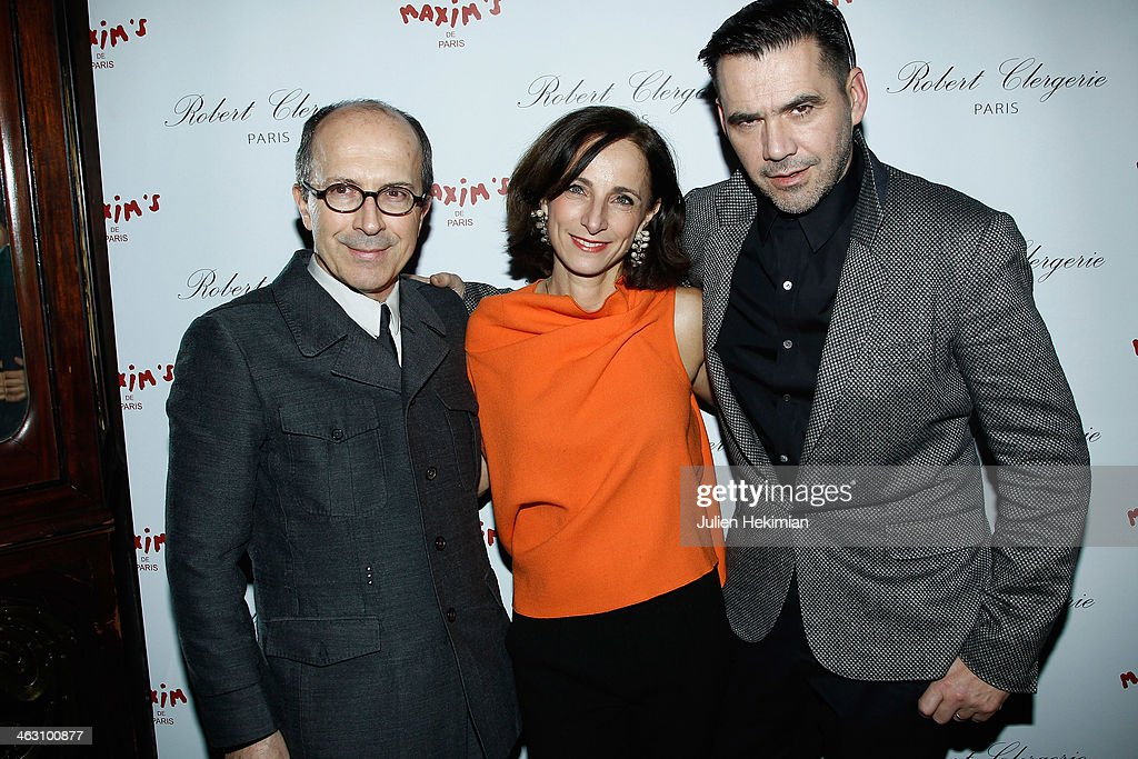 Jean-Marc Loubier, Eva Taub and <a gi-track='captionPersonalityLinkClicked' href=/galleries/search?phrase=Roland+Mouret+-+Fashion+Designer&family=editorial&specificpeople=4863595 ng-click='$event.stopPropagation()'>Roland Mouret</a> attend the Robert Clergerie and <a gi-track='captionPersonalityLinkClicked' href=/galleries/search?phrase=Roland+Mouret+-+Fashion+Designer&family=editorial&specificpeople=4863595 ng-click='$event.stopPropagation()'>Roland Mouret</a> Cocktail Party as part of Paris Fashion Week on January 16, 2014 in Paris, France.