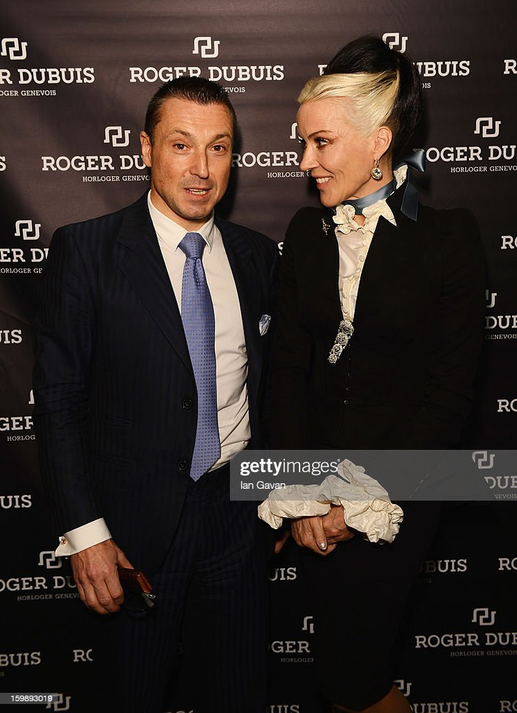Jean-Marc Pontroue, CEO of Roger Dubuis and Daphne Guinness, friend of the brand pose at the Roger Dubuis booth during the 23rd Salon International de la Haute Horlogerie at the Geneva Palexpo on January 22, 2013 in Geneva, Switzerland.