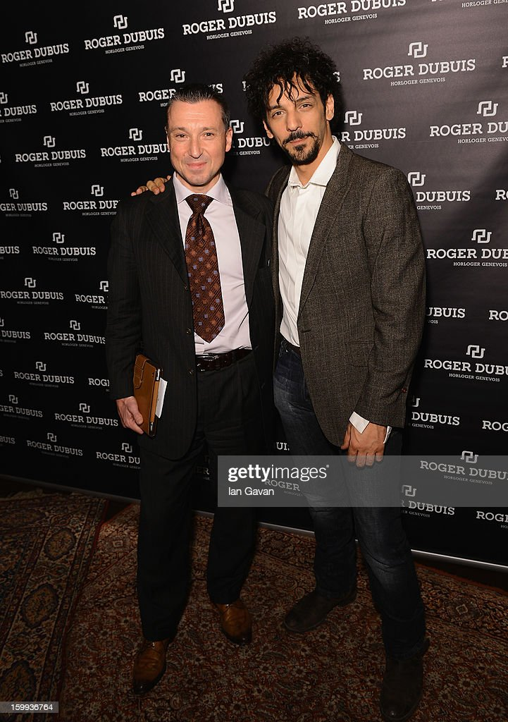 Jean-Marc Pontroue (L), CEO of Roger Dubuis and friend of the brand, <a gi-track='captionPersonalityLinkClicked' href=/galleries/search?phrase=Tomer+Sisley&family=editorial&specificpeople=2130669 ng-click='$event.stopPropagation()'>Tomer Sisley</a> pose in the booth during the 23rd Salon International de la Haute Horlogerie at the Geneva Palexpo on January 23, 2013 in Geneva, Switzerland.