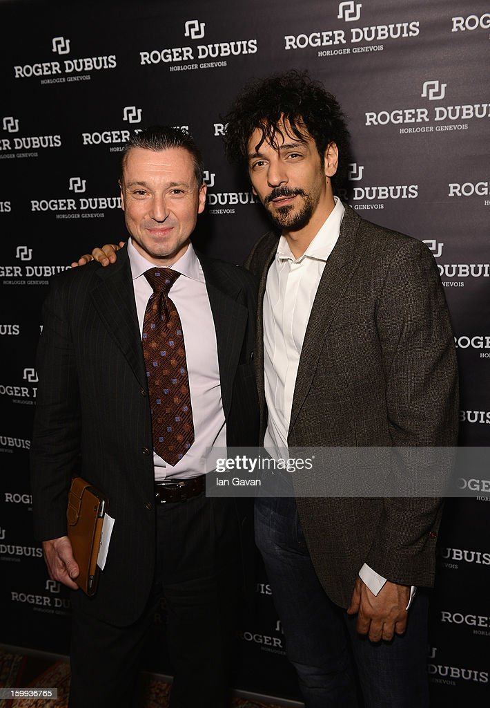 Jean-Marc Pontroue (L), CEO of Roger Dubuis and friend of the brand, Tomer Sisley pose in the booth during the 23rd Salon International de la Haute Horlogerie at the Geneva Palexpo on January 23, 2013 in Geneva, Switzerland.