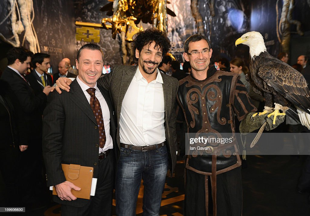 Jean-Marc Pontroue (L), CEO of Roger Dubuis and friend of the brand, <a gi-track='captionPersonalityLinkClicked' href=/galleries/search?phrase=Tomer+Sisley&family=editorial&specificpeople=2130669 ng-click='$event.stopPropagation()'>Tomer Sisley</a> (C) pose with an eagle in the booth during the 23rd Salon International de la Haute Horlogerie at the Geneva Palexpo on January 23, 2013 in Geneva, Switzerland.