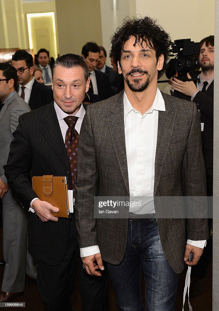 Jean-Marc Pontroue (L), CEO of Roger Dubuis and friend of the brand, Tomer Sisley enter the booth during the 23rd Salon International de la Haute Horlogerie at the Geneva Palexpo on January 23, 2013 in Geneva, Switzerland.