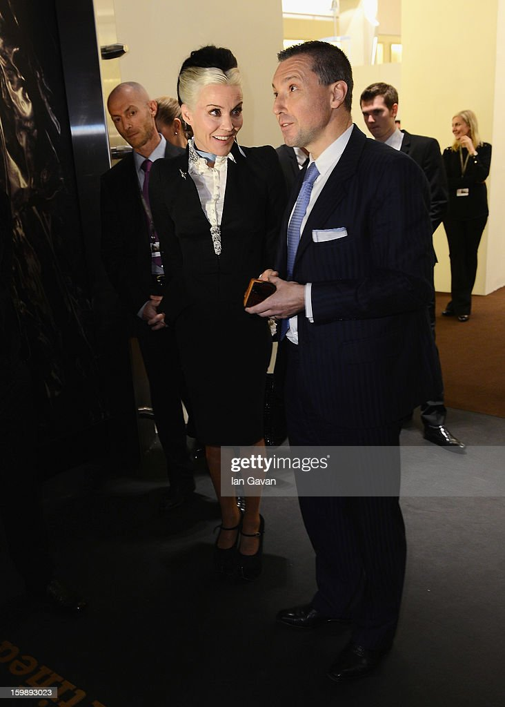 Jean-Marc Pontroue, CEO of Roger Dubuis talks to <a gi-track='captionPersonalityLinkClicked' href=/galleries/search?phrase=Daphne+Guinness&family=editorial&specificpeople=213037 ng-click='$event.stopPropagation()'>Daphne Guinness</a>, friend of the brand as she visits the Roger Dubuis booth during the 23rd Salon International de la Haute Horlogerie at the Geneva Palexpo on January 22, 2013 in Geneva, Switzerland.