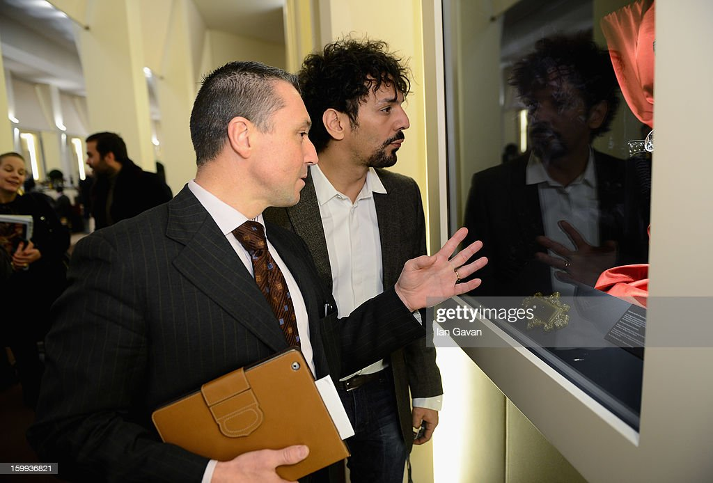 Jean-Marc Pontroue (L), CEO of Roger Dubuis talks to friend of the brand, <a gi-track='captionPersonalityLinkClicked' href=/galleries/search?phrase=Tomer+Sisley&family=editorial&specificpeople=2130669 ng-click='$event.stopPropagation()'>Tomer Sisley</a> in the booth during the 23rd Salon International de la Haute Horlogerie at the Geneva Palexpo on January 23, 2013 in Geneva, Switzerland.