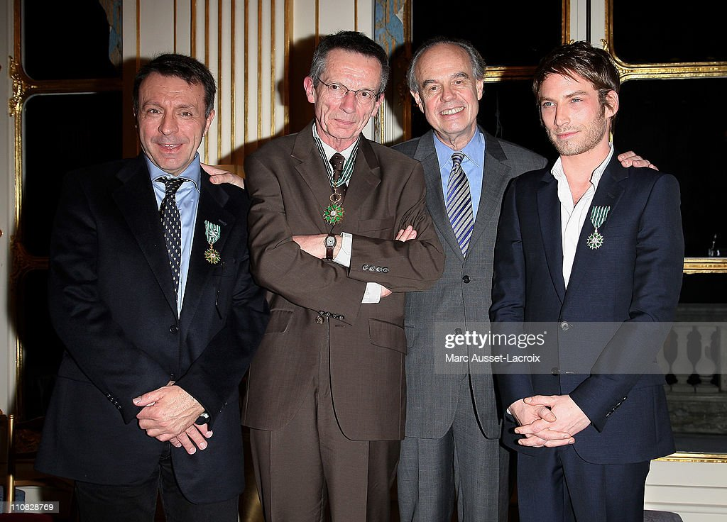 JeanMarie Boursicot Patrice Leconte French culture Minister Frederic Mitterrand and Ora Ito pose together after being awarded Chevalier des Arts et...