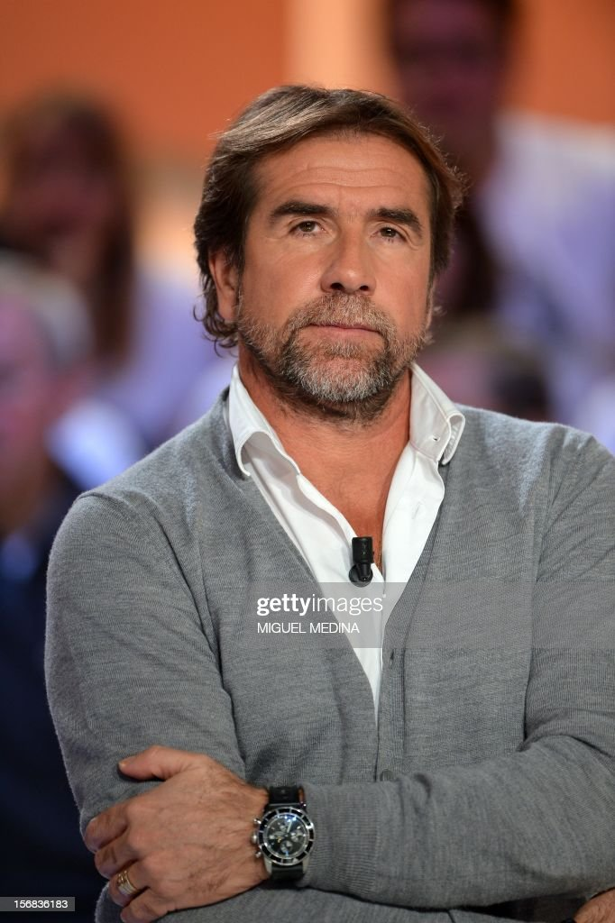 Jean-Marie Cantona takes part in the TV show 'Le grand journal' host by his brother former French football player turned actor Eric Cantona, on a set of French TV Canal+, on November 22, 2012 in Paris, as part of the launching of French charity association Abbe Pierre Foundation's winter campaign. AFP PHOTO MIGUEL MEDINA / AFP PHOTO / Miguel MEDINA