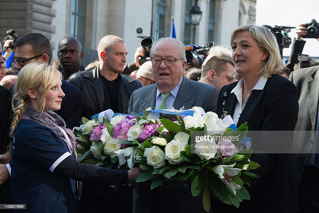 Jean-Marie Le Pen (L) and Marine Le Pen (R) arrive to lay down flowers in front of a statue of Jeanne D'Arc as part of Far Right Party May Day demonstration on May 1, 2012 in Paris, France. Marine Le Pen, the daughter of the French far-right leader Jean-Marie Le Pen, received only 6.4 million votes in the first round of the presidential elections. Both current French President Nicolas Sarkozy and French Socialist Party candidate Francois Hollande are now fighting to win support from the French Far Right ahead of the second round elections on May 6.