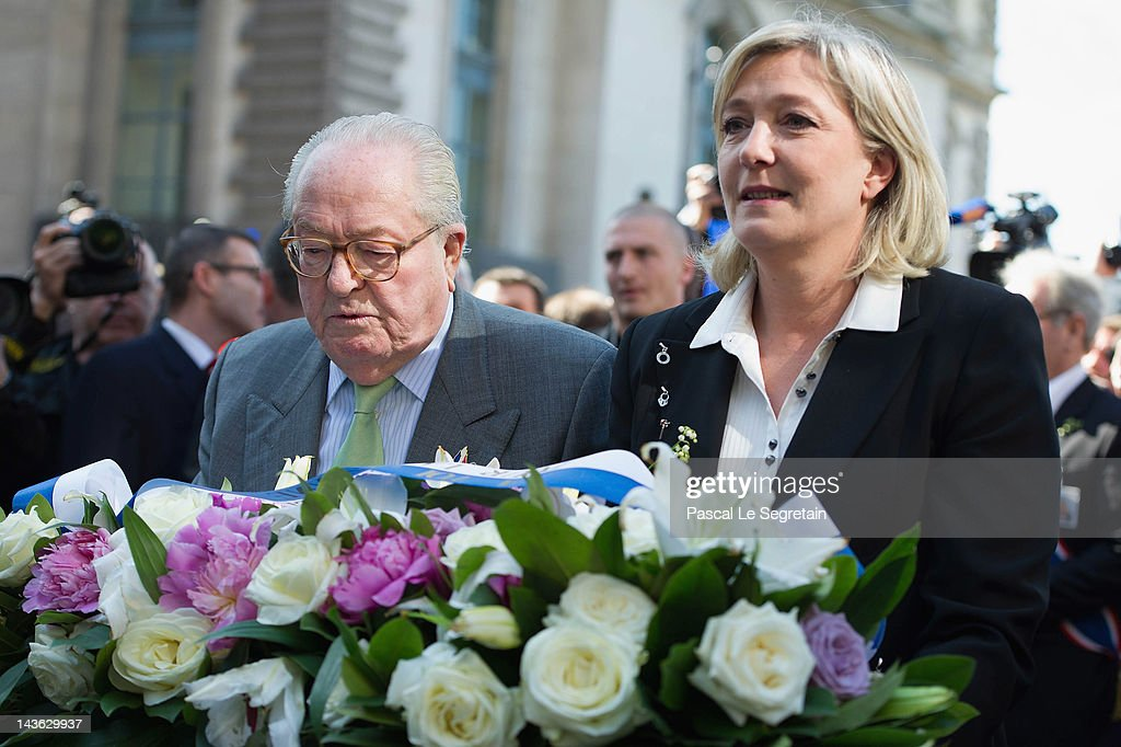 <a gi-track='captionPersonalityLinkClicked' href=/galleries/search?phrase=Jean-Marie+Le+Pen&family=editorial&specificpeople=214017 ng-click='$event.stopPropagation()'>Jean-Marie Le Pen</a> (L) and <a gi-track='captionPersonalityLinkClicked' href=/galleries/search?phrase=Marine+Le+Pen&family=editorial&specificpeople=588282 ng-click='$event.stopPropagation()'>Marine Le Pen</a> (R) arrive to lay down flowers in front of a statue of Jeanne D'Arc as part of Far Right Party May Day demonstration on May 1, 2012 in Paris, France. <a gi-track='captionPersonalityLinkClicked' href=/galleries/search?phrase=Marine+Le+Pen&family=editorial&specificpeople=588282 ng-click='$event.stopPropagation()'>Marine Le Pen</a>, the daughter of the French far-right leader <a gi-track='captionPersonalityLinkClicked' href=/galleries/search?phrase=Jean-Marie+Le+Pen&family=editorial&specificpeople=214017 ng-click='$event.stopPropagation()'>Jean-Marie Le Pen</a>, received only 6.4 million votes in the first round of the presidential elections. Both Sarkozy and Hollande are now fighting to win support from the French Far Right ahead of the second round.