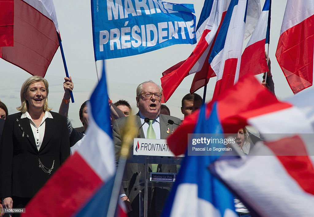 Jean-Marie Le Pen (L) and Marine Le Pen (R) stand on stage during French National Anthem at Far Right Party May Day demonstration on May 1, 2012 in Paris, France. Marine Le Pen, the daughter of the French far-right leader Jean-Marie Le Pen, received only 6.4 million votes in the first round of the presidential elections. Both Sarkozy and Hollande are now fighting to win support from the French Far Right ahead of the second round.