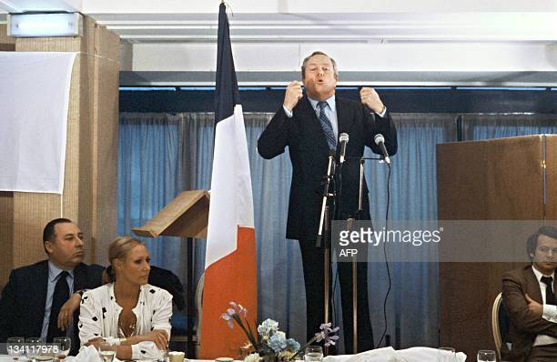 JeanMarie Le Pen France's farrighter and founder of the National Front addresses supporters 25 February 1980 in Paris while his wife Pierrette looks...