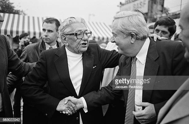 JeanMarie Le Pen leader of the extremist rightwing National Front shakes hands with Roland Gaucher The men have gathered at the Espace Balard concert...
