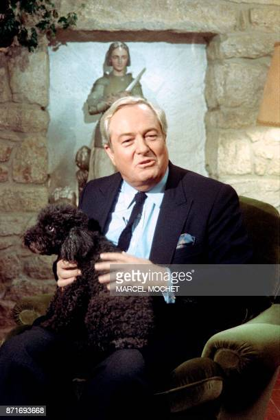 JeanMarie Le Pen Leader of the National Front from its foundation in 1972 and presidential candidate plays with his dog during an interviw at his...