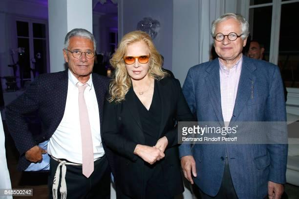 JeanMarie Perrier Sylvie Vartan and Bernard Fixot attend the Dinner after Sylvie Vartan performed at L'Olympia on September 16 2017 in Paris France