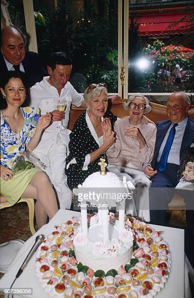 JeanMarie Proslier Irene Frain X Line Renaud and Arletty during a celebration for Arletty's 90th anniversary at the Plaza Athenee