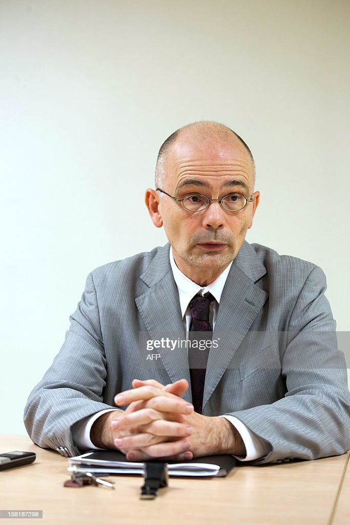 Jean-Marie Renault, academic director of the Charente region, answers journalists' questions during a press conference on December 10, 2012 in Angouleme, western France, after a French teacher who has been accused of asking her students to write an essay in which they imagined themselves as a suicidal teenager has been suspended pending an investigation. The teacher, who works at the Montmoreau-Saint-Cybard secondary school in the Charente region, will discover next week if she is to face disciplinary action following an outcry among parents over a composition she reportedly set for her class of 13- and 14-year-olds. PIERRE