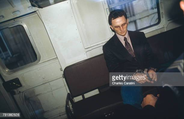 JeanMarie Villemin handcuffed in a police van on his way to court during his trial for the murder of Bernard Laroche Dijon France 5th November 1993...