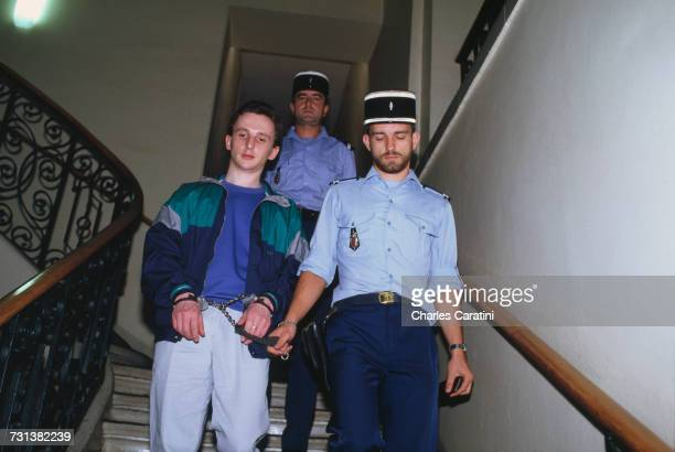JeanMarie Villemin handcuffed in police custody at the courthouse in Saverne in the BasRhin department during his trial for the murder of Bernard...