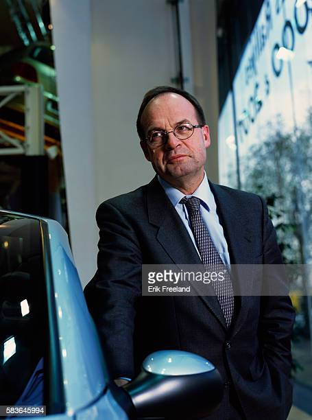 JeanMartin Folz CEO of Peugeot Citroen stands next to an automobile in a showroom in France Folz became head of Peugeot in 1997