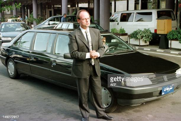 JeanMartin Folz president of PSA Peugeot Citroen stands 05 July in front of a Peugeot stretch 405 built in Iran for VIPs attending last year's eighth...
