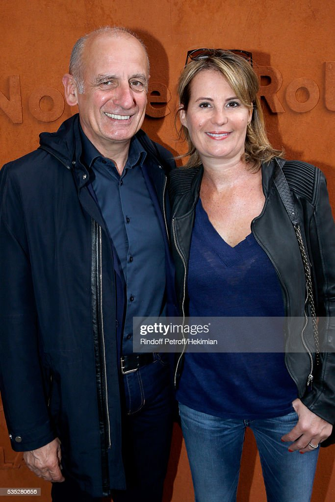 Jean-Michel Aphatie and his wife Stephanie attend Day Height of the 2016 French Tennis Open at Roland Garros on May 29, 2016 in Paris, France.
