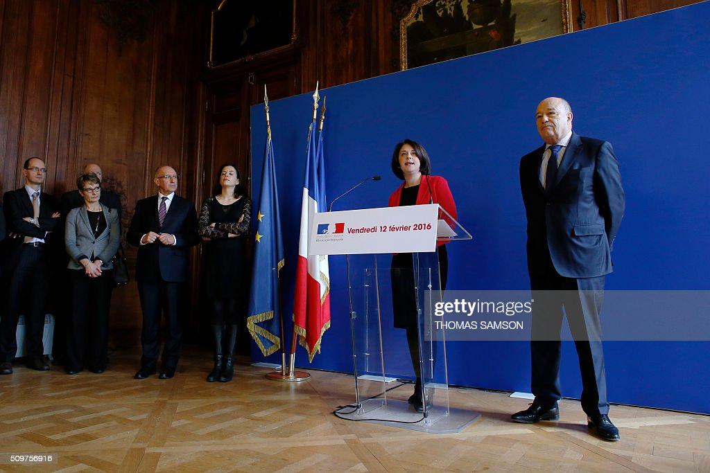 Jean-Michel Baylet (R), newly appointed minister for Minister of Town and Country Planning, Rural Affairs and Local Authorities, listens to France's outgoing Housing and Territories minister Sylvia Pinel (2ndR) on February 12, 2016 in Paris, during the handover ceremony. French President Francois Hollande reshuffled his cabinet on February 11, 2016, naming Jean-Marc Ayrault foreign minister and adding several ecologists to government as he seeks to widen his political base ahead of a presidential poll in 2017. SAMSON