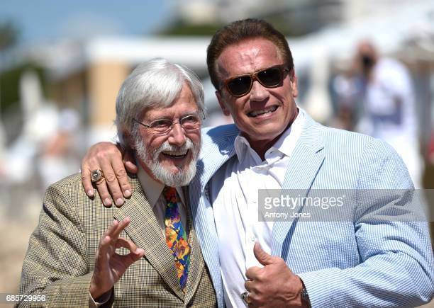 JeanMichel Cousteau and Arnold Schwarzenegger attend photocall for 'Wonders of the Sea 3D' during the 70th annual Cannes Film Festival at Nikki Beach...