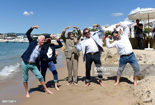 JeanMichel Cousteau Arnold Schwarzenegger and and guest attend photocall for 'Wonders of the Sea 3D' during the 70th annual Cannes Film Festival at...