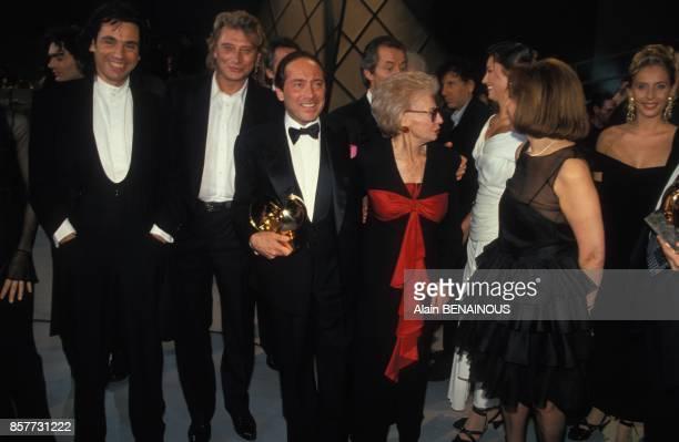 JeanMichel Jarre Johnny Hallyday et Paul Anka aux Victoires de la Musique le 7 fevrier 1994 a Paris France