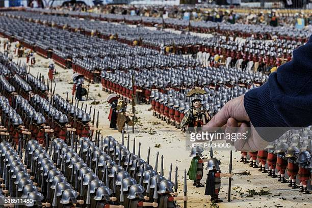 JeanMichel Leuillier arranges figures of his Playmobil diorama displaying the Battle of Zama fought in 202 BC and consisting of more than 26000...
