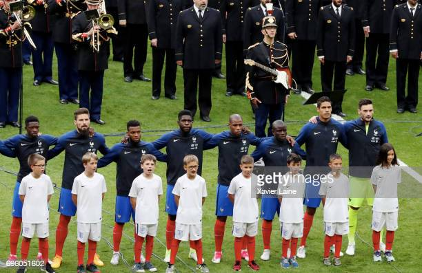 JeanMichel Mekil Gendarme of the Republican Guard sings and plays the guitar on 'Dont Look Back in Anger' of Oasis as a tribute to the victims of the...