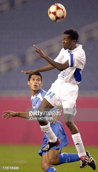 Jean-Michel Michaud of Martinique heads a ball past Ramos Alfredo Sanchez of El Salvador in the ...