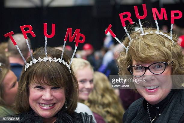 Jeanne Contanch and Shelly Kumfer wait for the start of a campaign event with Republican presidential candidate Donald Trump on December 21 2015 in...