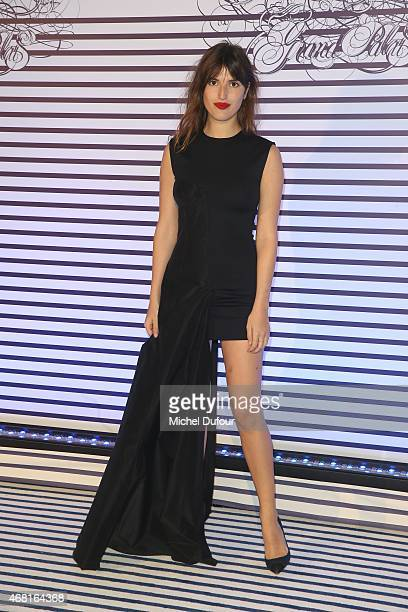 Jeanne Damas attends the Jean Paul Gaultier Exhibition photocall at Grand Palais on March 30 2015 in Paris France