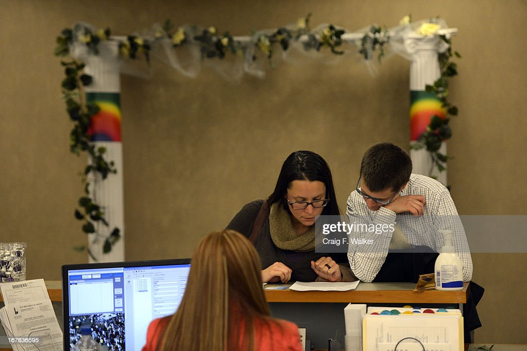 Jeanne Fischetti and Colleen Mentz, right, apply for their civil union license at the Webb Building in Denver CO, May 01, 2013. The Clerk and Recorder's Office opened for business from midnight to 3 a.m. to issue civil union licenses to couples on May 01, 2013 when the Civil Union Act became law. One Colorado offered a civil-union celebration for couples in the building's atrium from midnight to 2 a.m., as judges, magistrates and other officiants performed the ceremonies. Colorado became the latest state to recognize the legal rights of same-sex couples — through marriage or civil unions — when Gov. John Hickenlooper signed state Senate Bill 11 into law March 21.