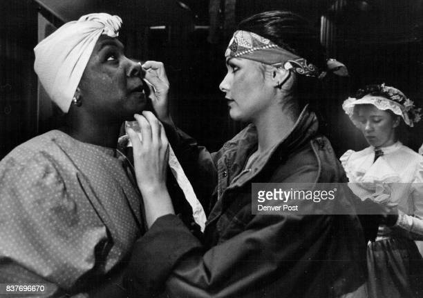 Jeannette wipes a tear form the eye of Raynell trying not a disturb her make=up just before the performance The cast had presented Marie their...