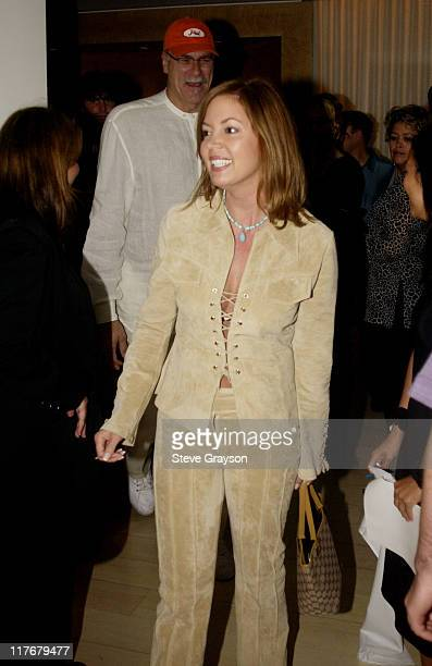 Jeannie Buss Phil Jackson pose for photographers at the Los Angeles Lakers victory celebration at Ian Schrager's Ultra Chic Mondrian Hotel