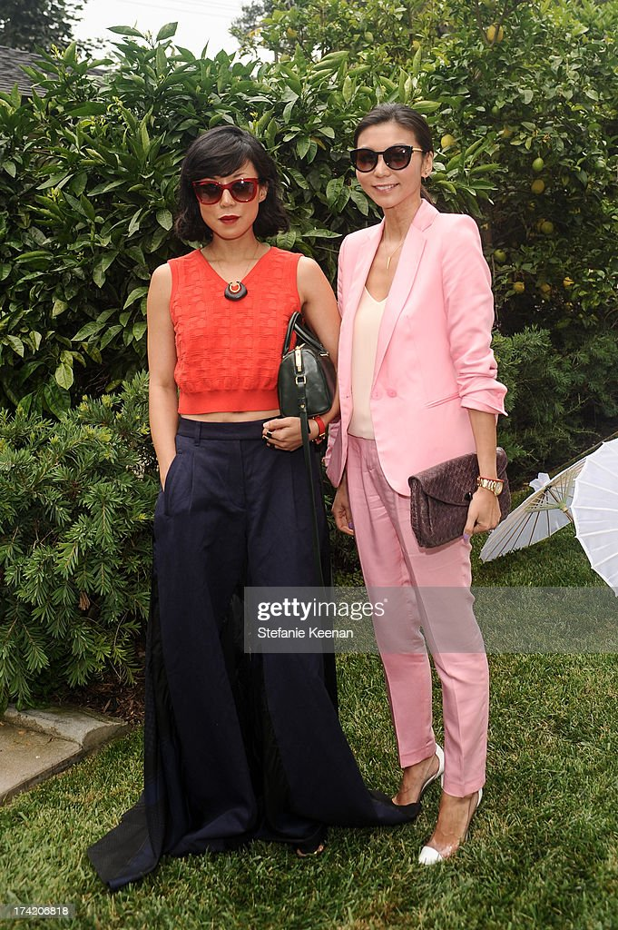 Jeannie Lee and Christine Kim attend LAXART 2013 Garden Party on July 21, 2013 in Los Angeles, California.