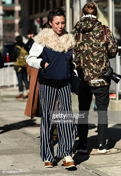 Jeannie Lee is seen outside the Calvin Klein show wearing striped pants during New York Fashion Week Women's Fall/Winter 2016 on February 18 2016 in...