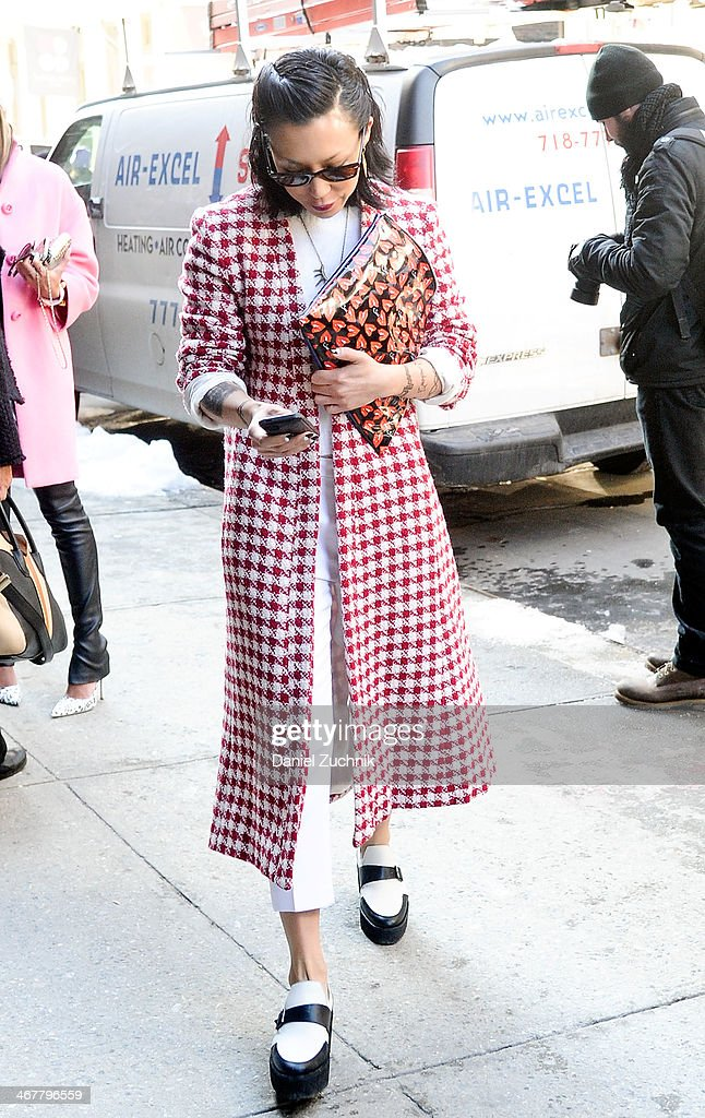 Jeannie Lee is seen outside the Jason Wu show wearing a Satine label coat, Jenni Kayne sweater, Undercover bag and Pierre Hardy shoes on February 7, 2014 in New York City.