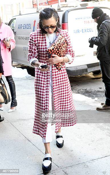 Jeannie Lee is seen outside the Jason Wu show wearing a Satine label coat Jenni Kayne sweater Undercover bag and Pierre Hardy shoes on February 7...