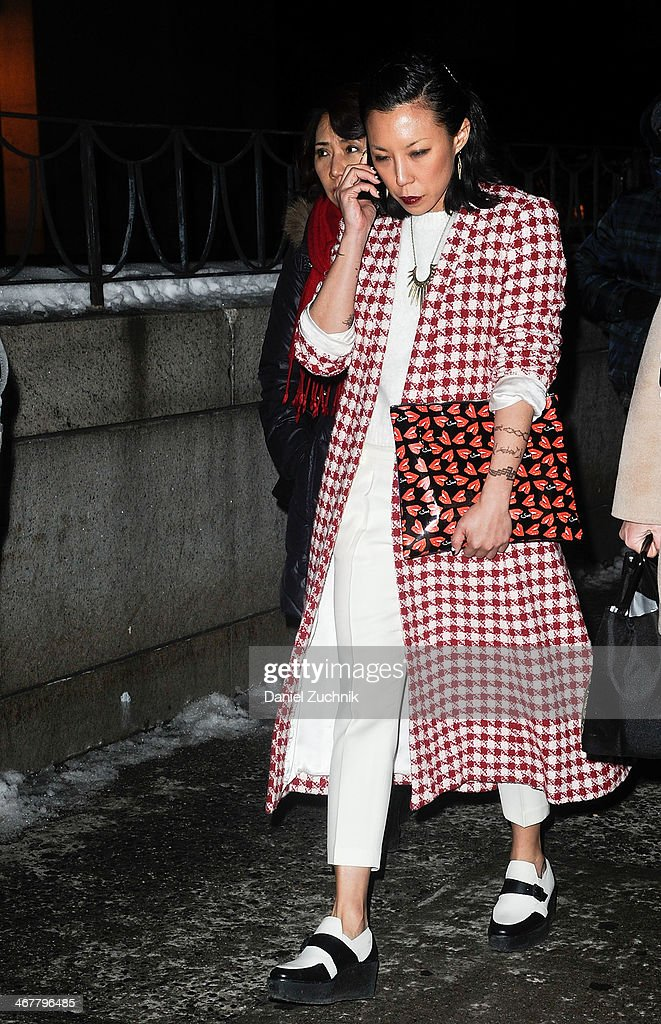 Jeannie Lee is seen outside the Rag and Bone show wearing a Satine label coat, Jenni Kayne sweater, Undercover bag and Pierre Hardy shoes on February 7, 2014 in New York City.