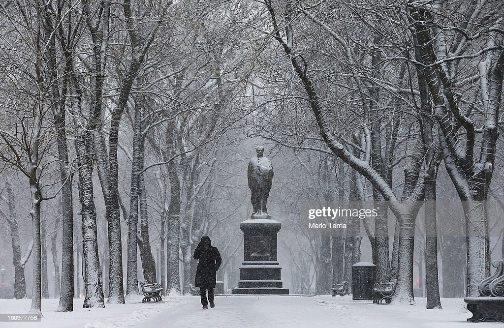 Jeannine Strampel walks through the snow past a statue of Alexander Hamilton along Commonwealth Avenue Mall on February 8, 2013 in Boston, Massachusetts. Massachusetts and other states from New York to Maine are preparing for a major blizzard with possible record amounts of snowfall in some areas.