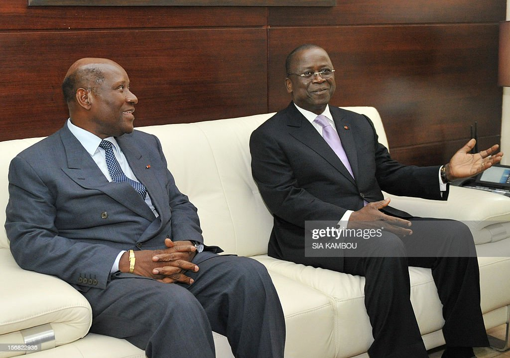 Jeannot Kouadio Ahoussou (r) outgoing prime minister and new premier Daniel Kablan Duncan (l) sit together before the handover on November 22, 2012 in Abidjan .The 69-year-old, a member of former president Henri Konan Bedie's PDCI party, was named to succeed Ahoussou after Ouattara dissolved the government on November 14. AFP PHOTO/ SIA KAMBOU