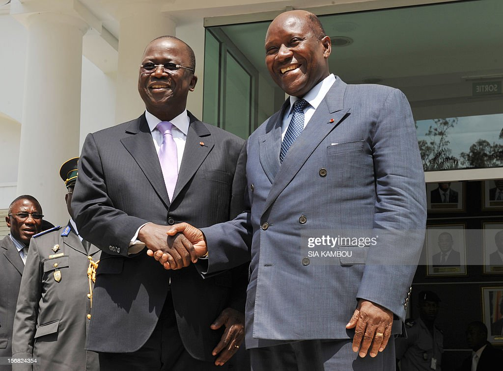 Jeannot Kouadio Ahoussou (l) outgoing prime minister and new premier Daniel Kablan Duncan (r) shake hands after the handover on November 22, 2012 in Abidjan .The 69-year-old, a member of former president Henri Konan Bedie's PDCI party, was named to succeed Ahoussou after Ouattara dissolved the government on November 14.