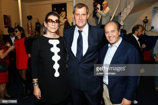 JeanPascal Hesse is pictured during his book signing with Prosper Assouline and his wife Martine Assouline at Pierre Cardin Museum as part of the...