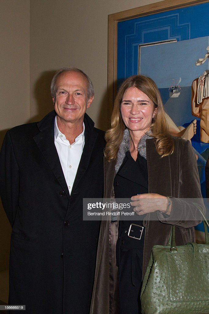 Jean-Paul Agon, CEO of l'Oreal, and his companion Sophie Scheidecker attend Dali Private Exhibition Preview at Centre Pompidou on November 18, 2012 in Paris, France.