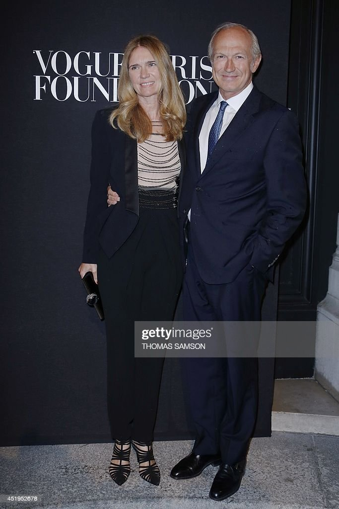 Jean-Paul Agon, CEO of L'Oreal, poses with his wife Sophie at the 'Vogue Paris Foundation' party in Paris on July 9, 2014.