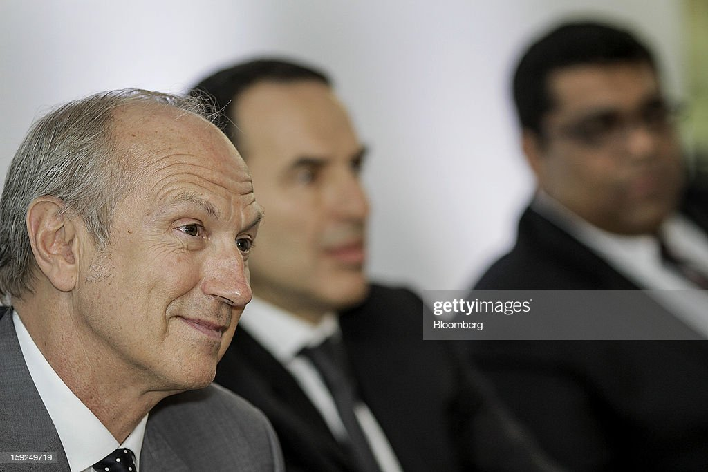 Jean-Paul Agon, chief executive officer of L'Oreal SA, from left, Laurent Attal, executive vice president of research and innovation for L'Oreal SA, and Mohamed Kanji, director of research and innovation for L'Oreal India Pvt. Ltd., listen during a news conference for the opening of the company's first research and innovation center in Mumbai, India, on Thursday, Jan. 10, 2013. L'Oreal SA, the world's largest cosmetics maker, today inaugurated its new Indian R&I center. Photographer: Dhiraj Singh/Bloomberg via Getty Images